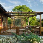 The pergola-topped master bathroom porch is shielded from the driveway and road by a Balinese screen, and sits on the site of what once was a sunken patio.