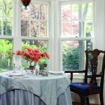 A bay window in the dining room offers an intimate alcove for Shepard and her partner, John.