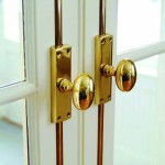Brass hardware is found on the French doors throughout the house.