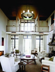 "The heart of the home is oversized and—with a 26 1/2' ceiling—ties together the other rooms of the house on both levels. Its central location ensures family members will pass through it frequently, reconnecting with each other as they do so and, as Rattner explains, ""actuating the space."" The reclaimed oak floors and board-and-batten ceiling enrich otherwise neglected planes and add to the natural aesthetic."