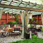Hullinger and Jones created a wonderful terrace setting, complete with cobblestone patio, stone walls, and rustic pergola.