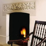The fireplace, with its carved stone lintel, anchors the house both inside and out.