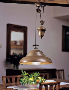 A brass pendant lamp with pulley from Country Gear Ltd. is a utilitarian take on late-19th-century technology that was usually hidden or seen only in industrial settings.