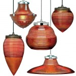 Reproduction prismatic glass pendants from Wilmette Lighting feature tinted amber glass.