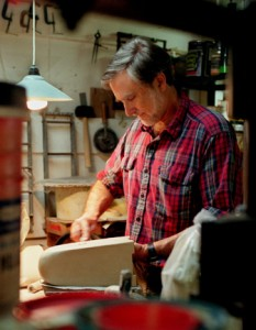 Artist Jim Webb of Studio 233 cuts his lamp bases from sheets of clay, then shapes them by hand.