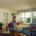 A band of three six-over-one windows in the living room looks out to Marblehead Harbor.