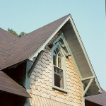 White cedar shingles appear in contrasting random and diamond-shaped patterns.