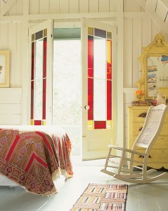 The architects preserved these stained glass doors, which open to a small balcony off the Green house master bedroom.