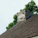Chimney modifications help prevent sparks from landing on the cedar shingle roof.