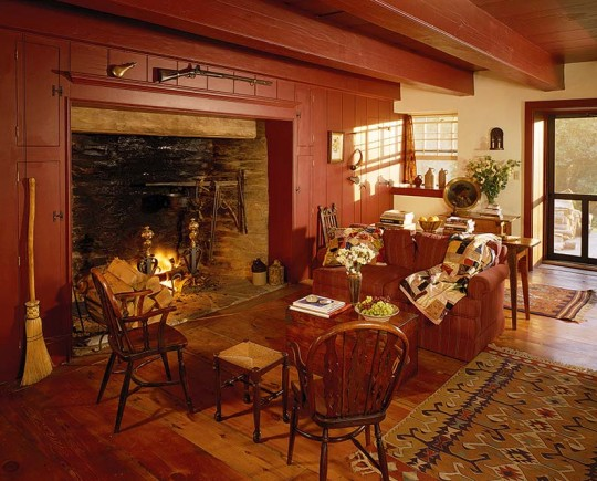 The original cooking hearth was restored. The room's deep colors make the interior cozy.