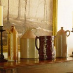 The homeowners' collection of rustic pottery fits the antique space.