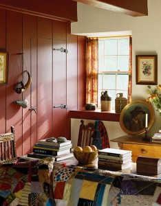 Paneled walls and doors that line these small rooms were made by hand using wide wood planks and are painted deep colors, which reflect the home's era.