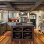 The kitchen floor was created from century-old wood repurposed from another (dilapidated) Will Price-designed house; many countertop appliances are hidden behind the custom cabinets.