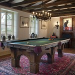 The Craftsman-style pool table, with arches echoing  the curves on the windows, dates to 1904 and was purchased on eBay.