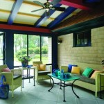 The screened area between the two shingled pavilions is painted inside with bright primary colors.
