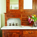 """When Shepard couldn't find the perfect antique sink and vanity, she asked Vitzthum to design this bird's-eye maple bathroom """"dresser"""" with a marble sink and countertop."""