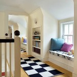 The upstairs hall offers a series of built-in benches and bookcases.
