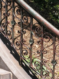 A rusted iron railing that's weathered many years outside can be returned to a good-as-new appearance with these simple steps.