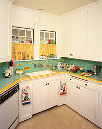 A less common countertop material, tile allowed for great expression and color combinations, such as the decor in this kitchen circa 1940, and was appreciated for its practicality because damaged tiles could be replaced individually. Photo Courtesy of Linda Svendsen