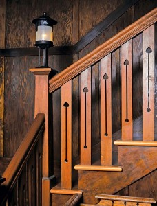 Newel-post fixtures were also common in Arts & Crafts homes; this simple post lamp represents one of the more basic types of configurations available.
