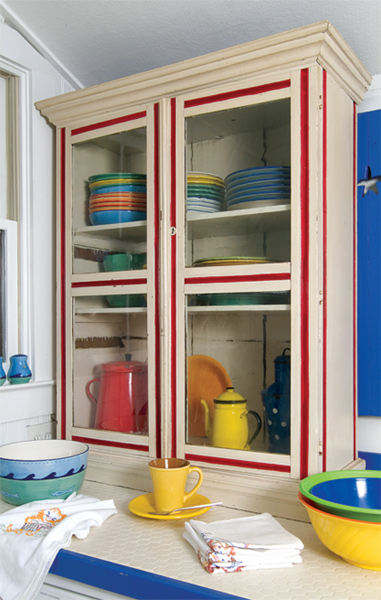 Got funky old cabinets? Paint them in sunny colors, or replace them with found built-ins, painted or striped.