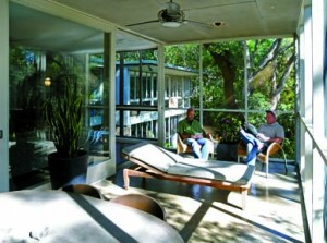 "An expansive screened-in porch is reached via gigantic sliding-glass doors that are still in excellent working condition. ""They're my favorite part of the house,"" says Mark."