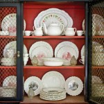 The owner's classic Wedgwood collection fills a 20th-century reproduction cabinet.
