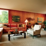 Furnishings include comfortable Modern pieces and several with Asian influence,as with the coffee table.  Lillian recalls that her husband Bill hated moving the heavy pieceout of the way of the Murphy bed in their first apartment, and vowed to build ahouse around it--which they did. (Artwork by Harold Thomas-Sims)