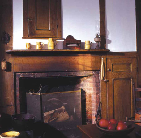 The old kitchen fireplace is in the original building, now an ell behind the brick manse.