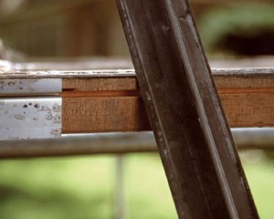 "The raised ""track"" on a flanged weatherstrip slides in a groove on the sash edge, creating an integral seal. Locate the proper position for the groove by laying the strip upside-down on the sash."