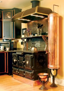 David Erickson of Erickson's Antique Stoves used the stove's central firebox to disguise<br> the wiring and controls for the new electric cooktop.