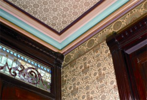 In an authentic period decorating scheme, note how the trim paint brings out the 'Arbella' wallpaper (J.R. Burrows) without exactly matching any of its colors.