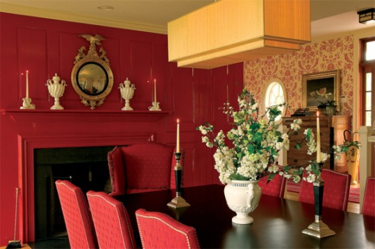 Farrow & Ball's 'Rectory Red' is echoed in the firm's 'St. Antoine Damask' wallpaper.