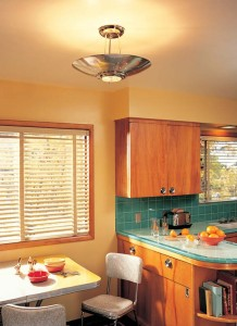 Outer space was a recurring theme in 1950s lighting, as evident in this kitchen's ceiling pendant, which appears ready to fly away; the light, from Rejuvenation, is a new design based on early models.