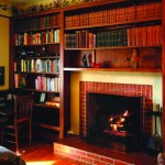 Built-in bookcases surrounding a fireplace maximize unused real estate on the wall, and are easily accessible on lazy afternoons. [Photo: Clare Martin]