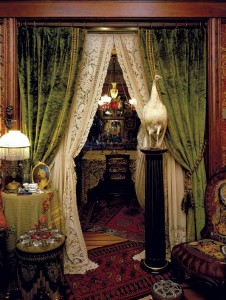 Portières, or doorway curtains, used the same rods and rings as window treatment. Popular from the 1870s until the end of the century, portières framed the entrances to public rooms, such as a parlor or dining room.