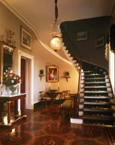 Stair rods, which first emerged in the late 18th century, were more elaborate in wealthy homes. Instead of plain cylinders, the ornate bars greeting visitors to the Edgewater Mansion in Barrytown, New York, are flat and fitted on each side with brackets that attach to the riser.