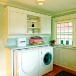 A new laundry area is topped with cabinets and shelves made era appropriate with beadboard and compound-profiled supports.