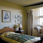 A collection of swans in the window bay gives the Swan Bedroom its name;18th-century silhouettes and an engraving of Madame de Sevigne hang above the faux-bamboo bed.