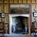 The Tudor Bedroom features trompe l'oeil panels painted in 1984;the 16th-century fireplace is original, and carved chairs are 17th century.