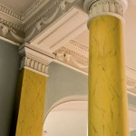The front entry was returned to its original classical grandeur with faux-painted columns and an unusual ox-head frieze.