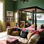 The Green Bedroom is centered on a William IV canopied bed and furnished with needlework pillows and stools.