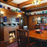 An Arts & Crafts aesthetic is strong in the dining room, with its original oak woodwork.