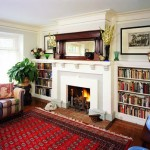 Built-in bookcases around the substantial living room fireplace continue the Arts & Crafts theme.