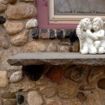 An original exterior stone shelf, supported by tree-branch brackets mortared between stones, is one of the home's many well-conceived design details.