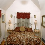 The rehabbed attic bedroom is a snug, comfortable space.