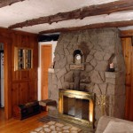 A massive original fireplace with built-in nooks  grounds the great room.