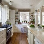 A farmhouse sink and tin ceiling add period touches to the bright kitchen.
