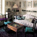 The owner's needlepoint covers two Chippendale chairs flanking a table filled with Eastern collectibles. The sofa was made in the 1930s; the original Chippendale piece is at Colonial Williamsburg.
