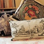 Needlepoint pillows are patterned after the antique Chinese porcelain.